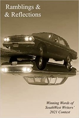 Car with headlights on with mirrored image beneath